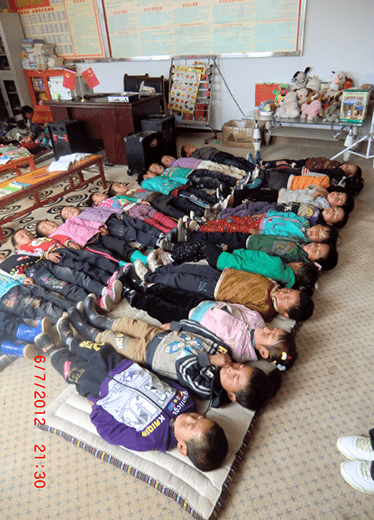 John-James Farquharson: Children having their afternoon siesta in the Xiaoxi Kindergarten